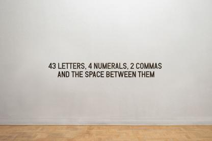 43 LETTERS, 4 NUMERALS, 2 COMMAS AND THE SPACE BETWEEN THEM