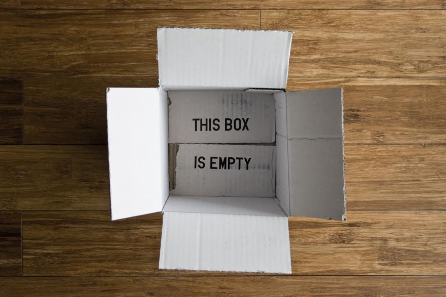 "An empty box with a ""THIS BOX IS EMPTY"" inscription."