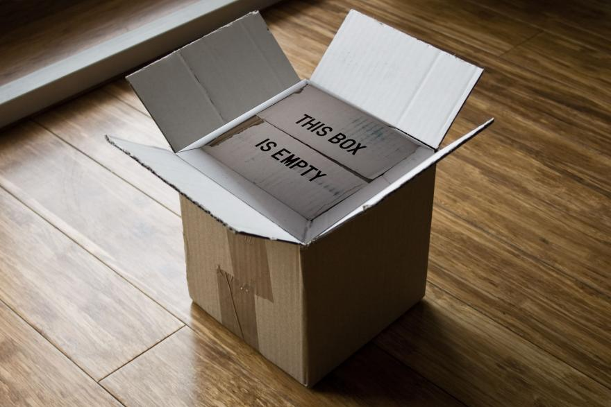 """An empty box with a """"THIS BOX IS EMPTY"""" inscription."""